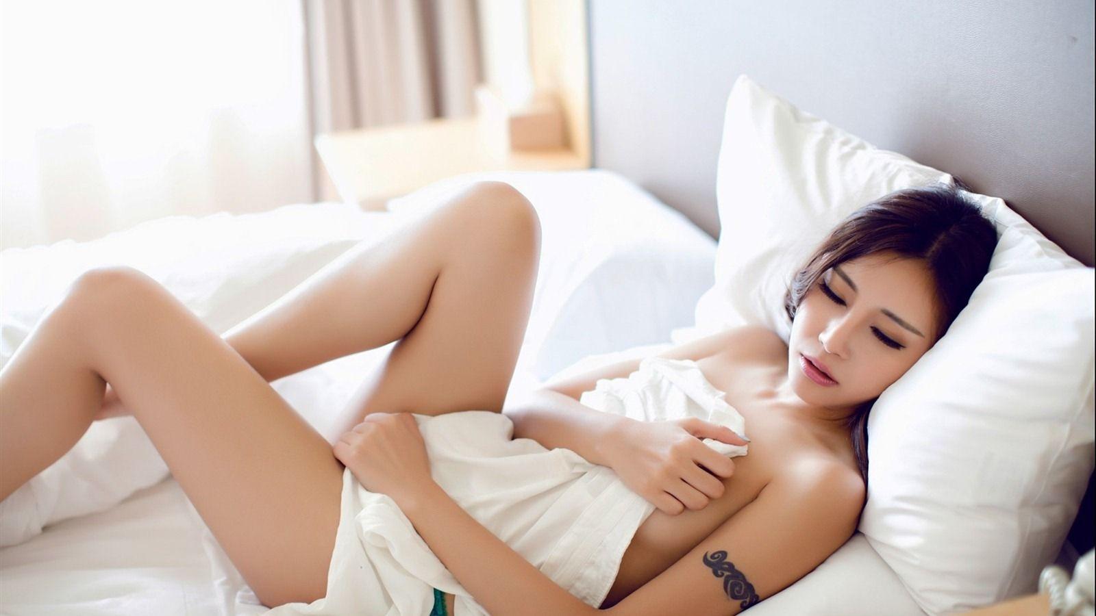 beautiful Asian girl laying bed